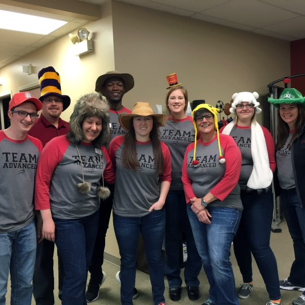 apt team wearing fun hats