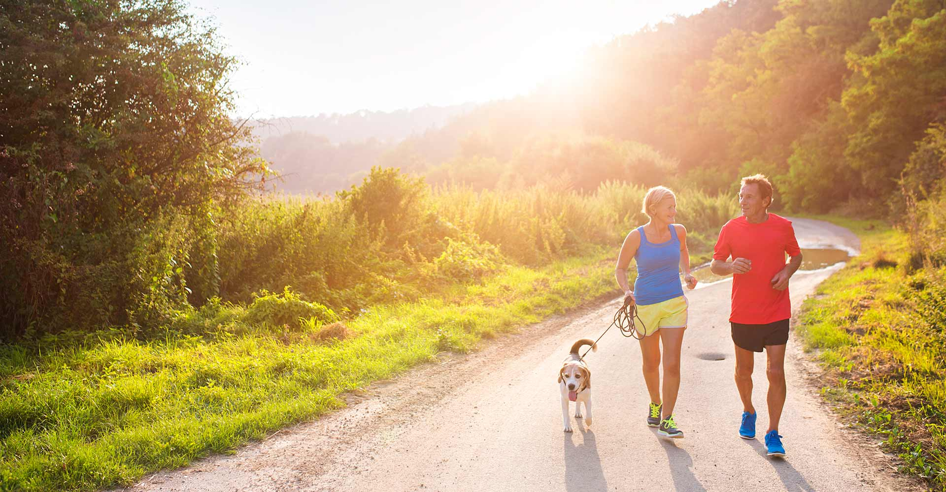 running couple with dog